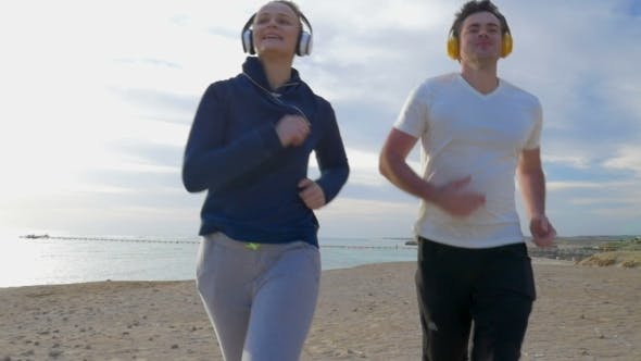 Thumbnail for Couple Jogging On The Beach