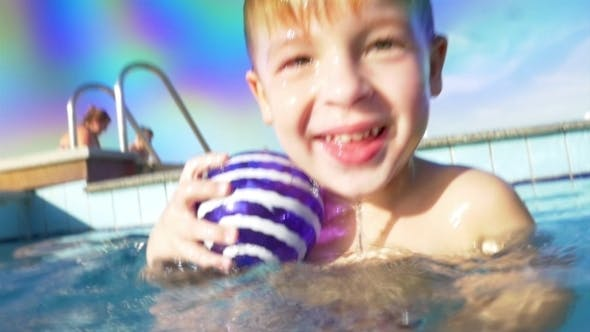 Thumbnail for Boy Diving And Coming Up From Water In The Pool