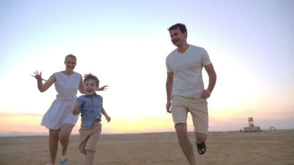 Thumbnail for Parents Having Happy Time With Child On The Beach