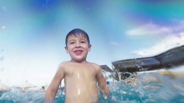 Thumbnail for Boy Having Fun In The Pool On Resort