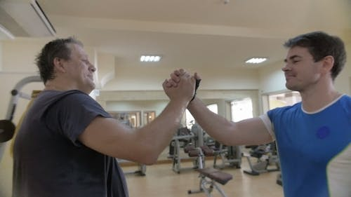 Firm Handshake Of Friends In The Gym