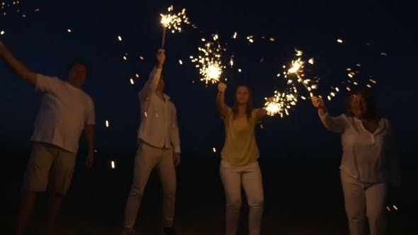 Thumbnail for Family With Sparklers On The Beach At Night