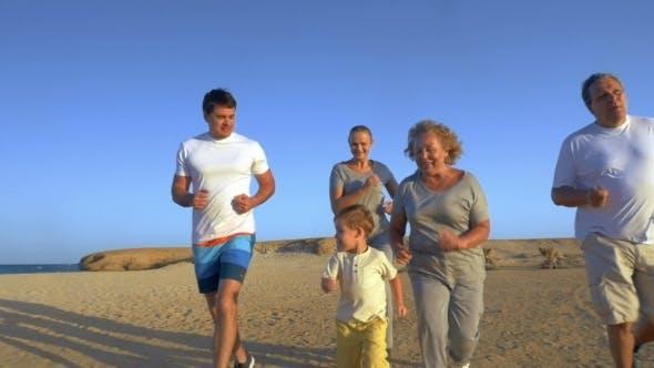 Big Family Jogging On The Coast