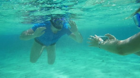 Thumbnail for Smartphone Helps Them To Make a Good Underwater