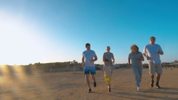 Thumbnail for Family Jogging On The Beach