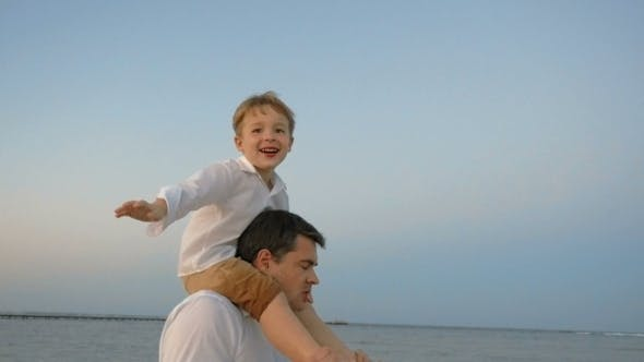 Thumbnail for Child Showing Plane Sitting On Fathers Shoulders