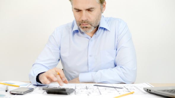 Architect Engineer Doing Calculations