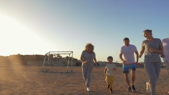 Happy Family Finishing Evening Jogging