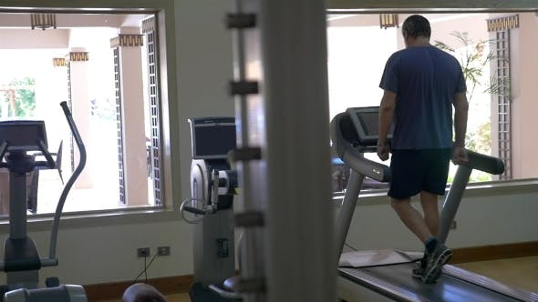 Thumbnail for Working Out On Treadmill In Modern Gym