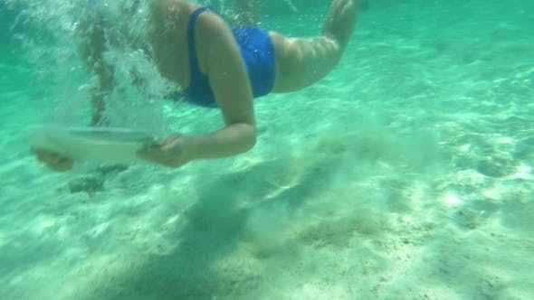 Thumbnail for Woman Using Pad To Make Underwater Shot