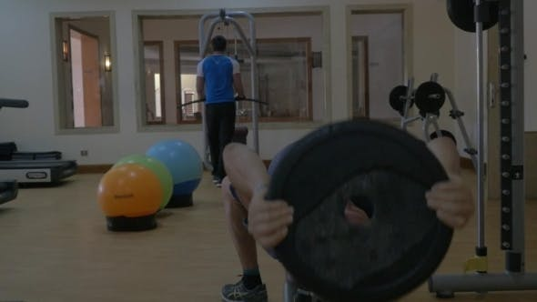 Thumbnail for Two Men Training Using Sporting Equipment In Gym