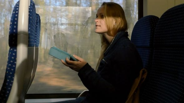Thumbnail for Woman With Tablet PC On Train