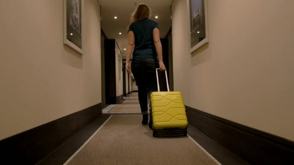 Thumbnail for Woman Walking Along The Hotel Passage With Trolley