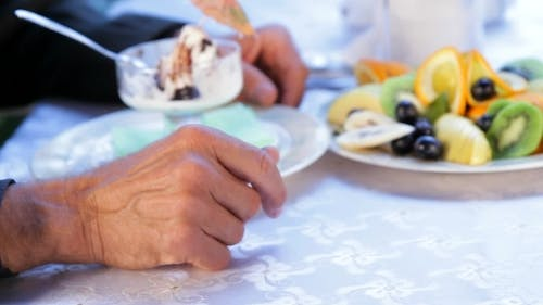 A Gentle Touch Of The Hands Of Older Spouses