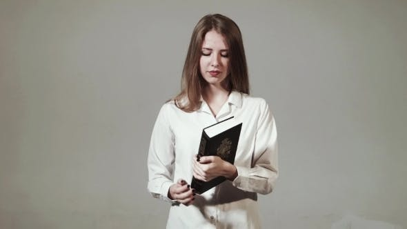 Cover Image for Young Christian Girl Reads The Bible