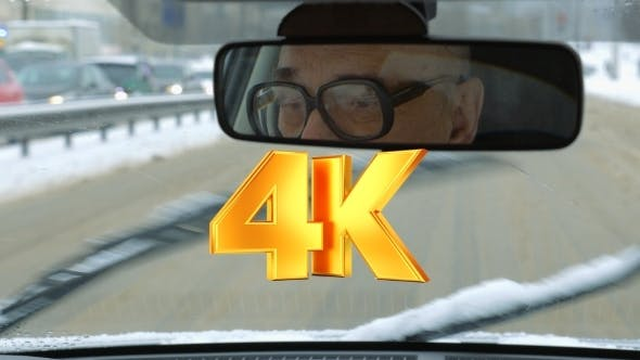 Thumbnail for Senior Man Driving a Car In Winter