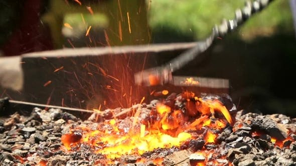 Burning Coal In The Forge