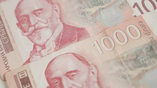 Shallow DOF  Serbian paper currency on pile  slow tilt 4K 2160p 30fps UltraHD footage - Wad with den