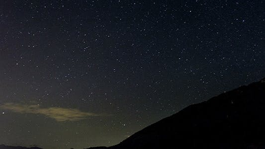 Thumbnail for Stars Moving In Night Sky Over Mountain Ridge