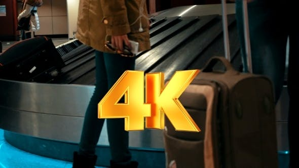 Thumbnail for People Getting Luggage On Conveyer Belt