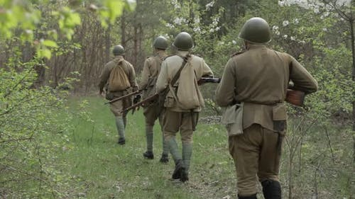 Russian Soviet Infantry Red Army Soldiers Of World War II Marching Walking Along Forest Road In