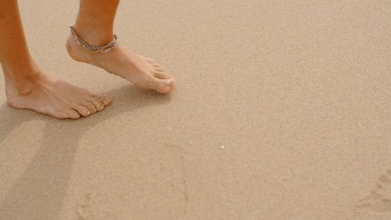 Cover Image for Bare Feet Coated In Sand Walking On Beach