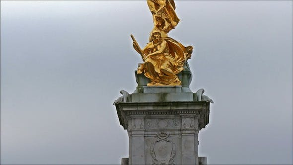 Thumbnail for The Golden Statue of a Man with Wings Infront