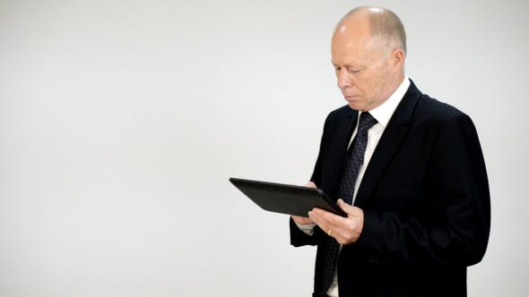 Thumbnail for Businessman Typing on Tablet PC