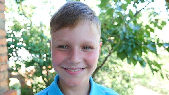 Thumbnail for Boy Looks At The Camera And Smiling
