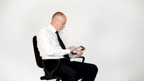 Cover Image for Relax Businessman Using Tablet