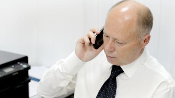 Thumbnail for Businessman Talking on Phone