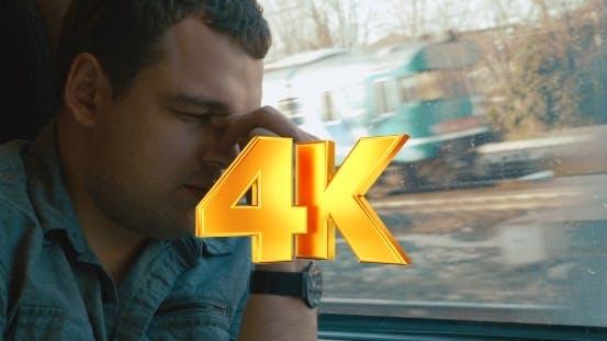 Thumbnail for Man Taking a Headache Pill In The Train