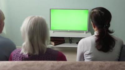 Family Watching TV. Green Screen.