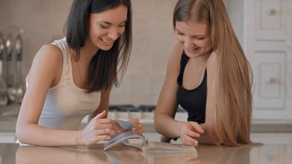 Thumbnail for Two Girls Reading Fashion Magazine
