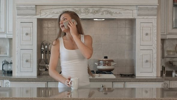 Thumbnail for Young Beautiful Woman Talking Cell Phone, Drink
