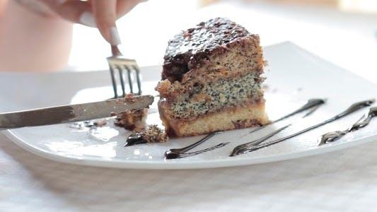 Thumbnail for The Girl Eats A Sweet Cake In Restaurant