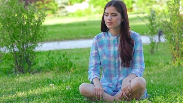 Thumbnail for Teen Girl Doing Yoga In The Park.