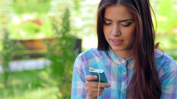 Thumbnail for Beautiful Girl In Park With Her Phone/player