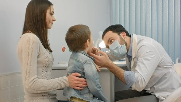 Thumbnail for Pediatrician Checking Little Boy Throat