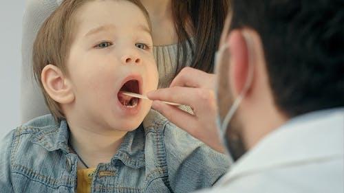 Little Boy Having Throat Examination