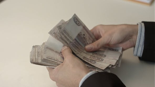 Thumbnail for Businessman Counts Money In Hands.