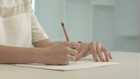 Thumbnail for Woman With Pencil Writing On Paper