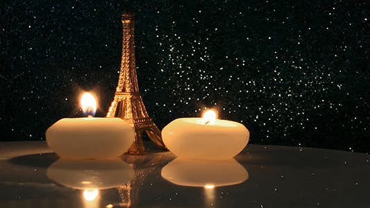 Thumbnail for Eiffel Tower with Candles on Glittering Background