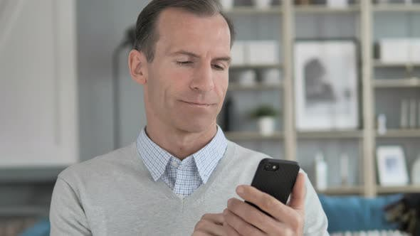 Thumbnail for Portrait of Middle Aged Man Busy Using Smartphone