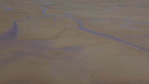 Wet sands from air