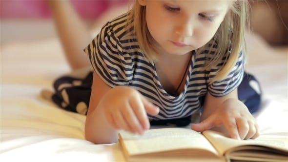 Thumbnail for Little Girl Reading Book