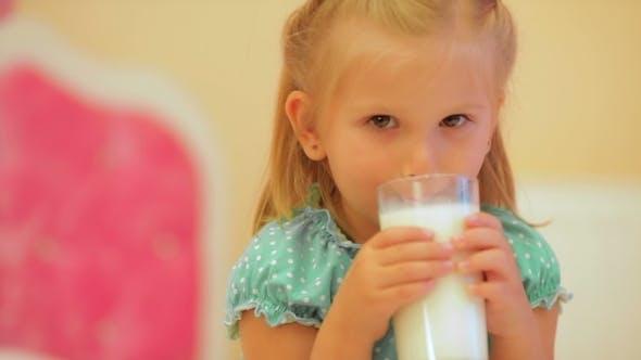 Thumbnail for Adorable Little Girl Drinking Milk