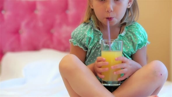 Adorable Little Girl Drinking Juice