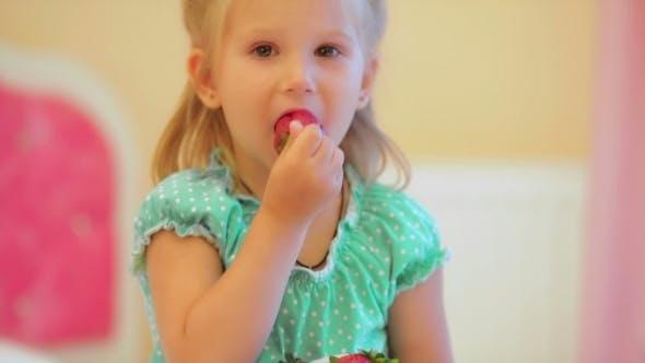 Thumbnail for Adorable Little Girl Eating Strawberries