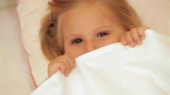 Thumbnail for Cute Little Girl Under The Blanket